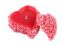 Bougie en forme de coeur de cire avec des roses Photo stock