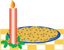 Bougie, houx et biscuits Image libre de droits