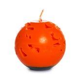 Bougie orange d'isolement sur le fond blanc Image libre de droits