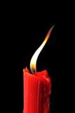 Bougie rouge à l'arrière-plan noir Images libres de droits