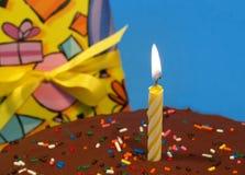 Bougie sur un gâteau birtday Photographie stock libre de droits