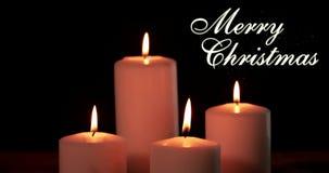 Bougies blanches et mots de Joyeux Noël banque de vidéos