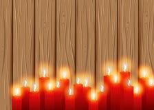 Bougies brûlantes sur un fond en bois cosiness illustration stock