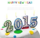 Bougies brûlantes avec le symbole de la nouvelle année 2015 Photos stock