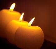 Bougies brûlantes de fond Photos stock