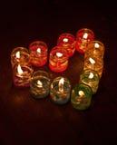 Bougies colorées dans un heartshape Photos stock