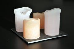 4 bougies d'un plat Photographie stock