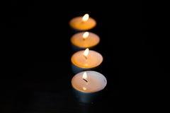 Bougies de Lit dans une rangée Images libres de droits