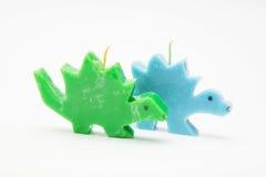 Bougies drôles de cadeau de souvenir sous forme de dragons multicolores Photographie stock libre de droits