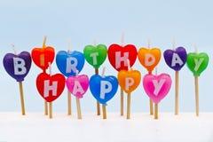 Bougies en forme de coeur d'anniversaire Images stock