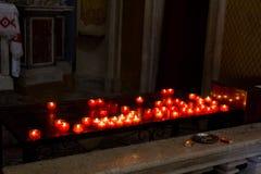 Bougies rougeoyantes Photographie stock libre de droits