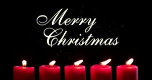 Bougies rouges avec des mots de Noël léger et Joyeux banque de vidéos