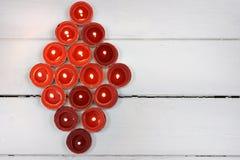Bougies rouges de lumière de thé Image stock