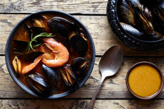 Bouillabaisse fish soup with prawns, mussels tomato, lobster. Sauce Rouille. Rustic style background. Stock Photo
