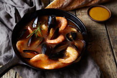 Bouillabaisse seafood fish soup with prawns, mussels tomato, lobster. Sauce Rouille. Rustic style background. Stock Image