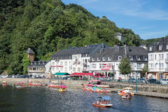 Bouillon along Belgian river Semois with tourists relaxing in paddle boats Royalty Free Stock Image