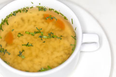 Bouillon. Beef soup in a bowl closeup Royalty Free Stock Photography