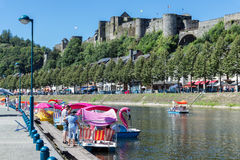Bouillon with castle and river Semois with pedalos, Belgium. BOUILLON, BELGIUM - AUG 13: Bouillon with castle and river Semois with pedalos for recreation on stock images