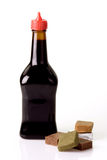 Bouillon cube. Brown bottle with soup flavour isolated on white background stock image