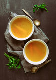 Bouillon served in two bowls Stock Photos