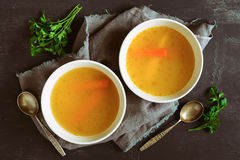 Bouillon served in two bowls Royalty Free Stock Image