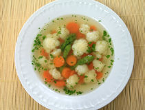 Bouillon soup. Broth soup (bouillon) with cauliflower, carrot and parsley. Polish cuisine Royalty Free Stock Photos