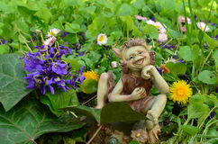 Bouket of Violets and dwarf doll Stock Photography