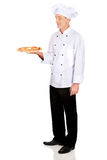 Boulanger de chef avec la pizza italienne Photo stock