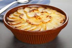 Boulangere o patatas horneadas a la crema y con pan rallado Fotografía de archivo libre de regalías