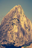 Boulder against blue sky on summer in the day time. Vintage pict Royalty Free Stock Images