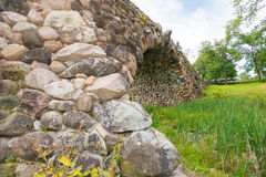 Boulder-arch bridge. Hundred-meter boulder-arch bridge with two grotto - aviary, called by locals Devil's Bridge. Consisting of dry stacked boulders, kept only Stock Photos