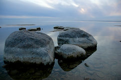 Boulder beach. Sunrise on the lake  tranquil water and boulder beach Royalty Free Stock Images