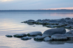 Boulder beach. Sunrise on the lake  tranquil water and boulder beach Stock Image