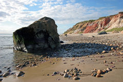 Boulder on the Beach. A boulder sits on a colorful beach landscape Stock Photography