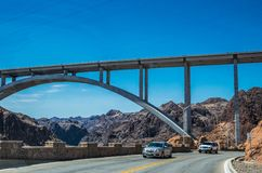 Engineering structures of Hoover Dam, Nevada. Cars crossing the Hoover Dam Royalty Free Stock Photography