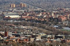 Boulder, Colorado. A view of downtown Boulder, Colorado. The shopping district is in the foreground and the University of Colorado - Boulder can be seen in the Stock Photo