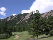 Boulder Colorado Flatirons. Hikers along Boulder Colorado Foothill Flatiron mountains, getting their outdoor recreation and fresh air from a nature walk Stock Photos