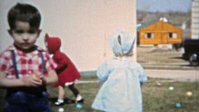 BOULDER, COLORADO 1951: Mom setting up Easter egg hunt for the children. stock video footage