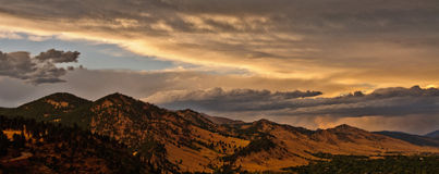 Boulder Colorado Mountain Range Panorama. Storm clouds approaching the mountain range to the west of Boulder, Colorado Stock Image