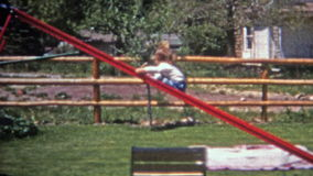 BOULDER, COLORADO 1952: Toddler sliding backwards down steep residential home slide. stock video footage
