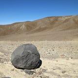 Boulder in Death Valley. Boulder in barren landscape in Death Valley National Park Royalty Free Stock Photography