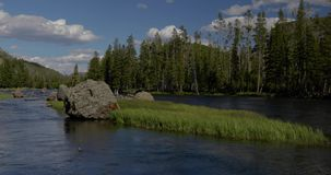 Boulder filled river with blue skies 4k 24fps