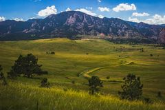 Boulder Flatirons. Flatirons mountain and valley with winding road on a summer day with blue sky and clouds, Boulder, Colorado Stock Photography