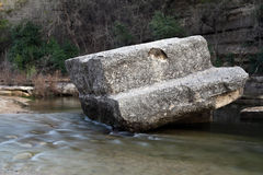 Boulder in flowing creek Stock Photography