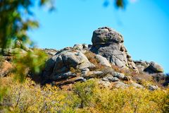 The boulder on the hill and blue sky. Dali lake scenic area.The photo was taken in Mando heights scenic area Hexigten Banner Chifeng city Inner Mongolia Royalty Free Stock Image