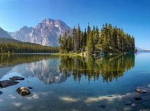 Boulder Island in Leigh Lake, Grand Teton National Park, WY, USA stock images