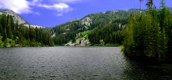 Boulder lake. Scenic view of Boulder lake with forested mountains in background, Idaho, U.S.A Royalty Free Stock Image