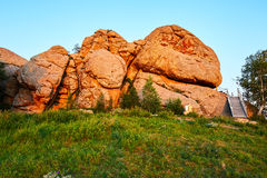 The boulder moorstone on the grassland sunset Royalty Free Stock Images