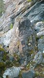 Boulder on mountain side. Close up of boulder on side of mountain Royalty Free Stock Images