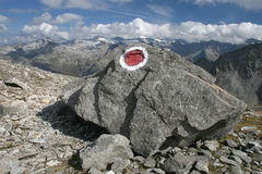 Boulder in the mountains. Boulder with tourist sign in the mountains royalty free stock image